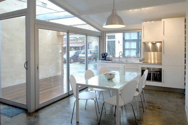 Epic Garage Conversion - A spacious kitchen and dining room.