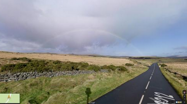 14 funny Google Street View images - A rainbow starting to develop in the distance.