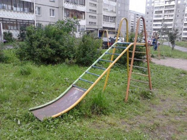 20 Creepy Playgrounds - This slide might hurt on the way down.