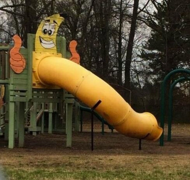20 Creepy Playgrounds - This slide is happy and gives an enthusiastic thumbs up to the whole package.