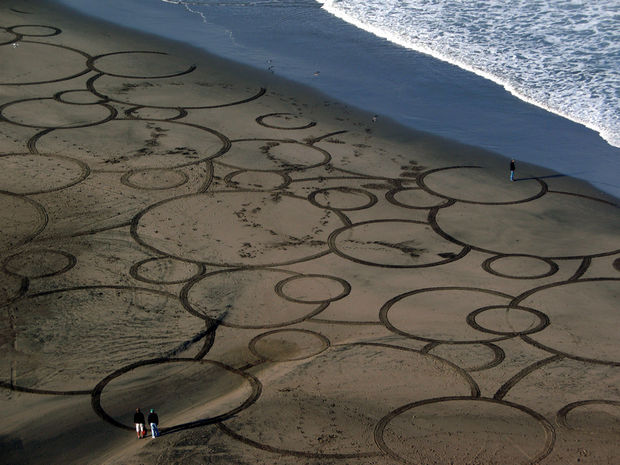 Drawing perfect circles on paper is difficult for most people but Amador draws 100-foot circles in the sand and makes it look so easy.