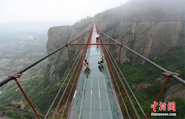 Glass Bridge in China - It has a 95-metre middle section made of glass and the entire bridge stretching 300-metres and suspended 180-metres above the ground.