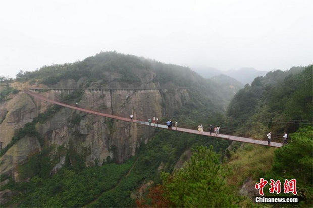 Glass Bridge in China - It's completely safe but it must also be completely terrifying.
