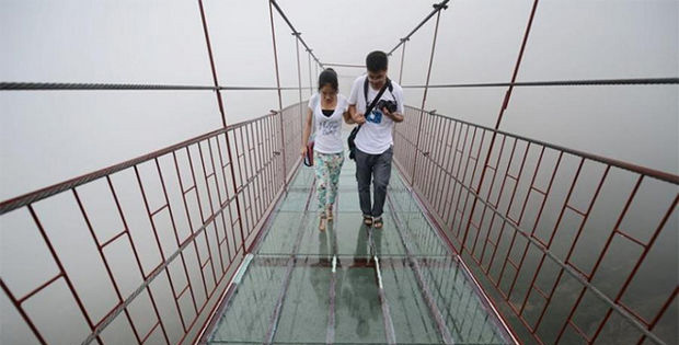 Glass Suspension Bridge in China Is a Huge Draw for Tourists.