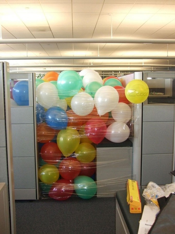 25 Office Pranks - Who wouldn't like a cubicle full of fun balloons?