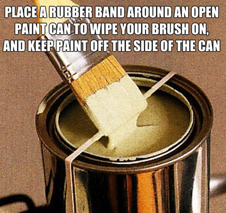 52 Cleaning and Life Hacks - Place a rubber band around an open paint can to wipe your brush on, and keep paint off the side of the can.