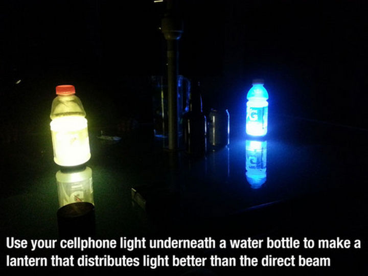 52 Cleaning and Life Hacks - Use your cellphone light underneath a water bottle to make a lantern that distributes light better than the direct beam.