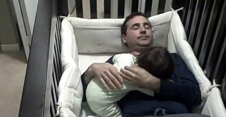 Dad Tries to Comfort His Baby Daughter by Sleeping in Crib.