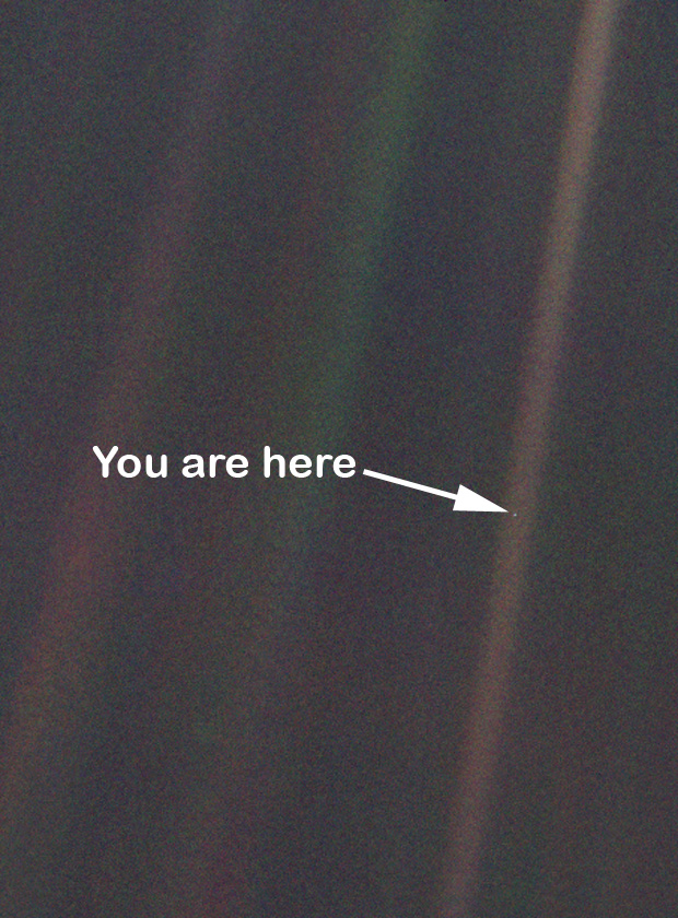 "This image of earth or ""the pale blue dot"" was taken by the Voyager 1 space probe in 1990."