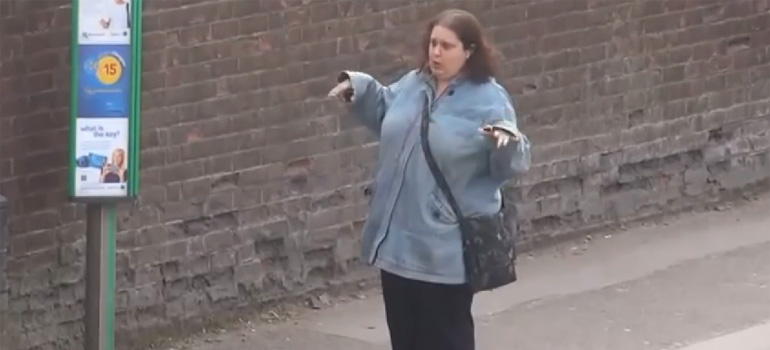 This woman waiting at the bus stop can't stop dancing.