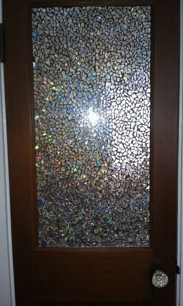 16 DIY Projects Using Old and Scratched CDs - Create a stunning mosaic door.