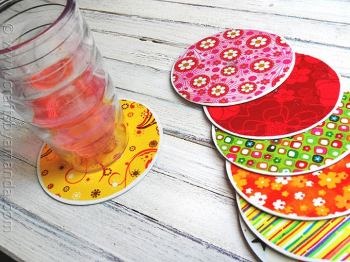 16 DIY Projects Using Old and Scratched CDs - Make decorative coasters with colorful fabric pasted onto old CDs.