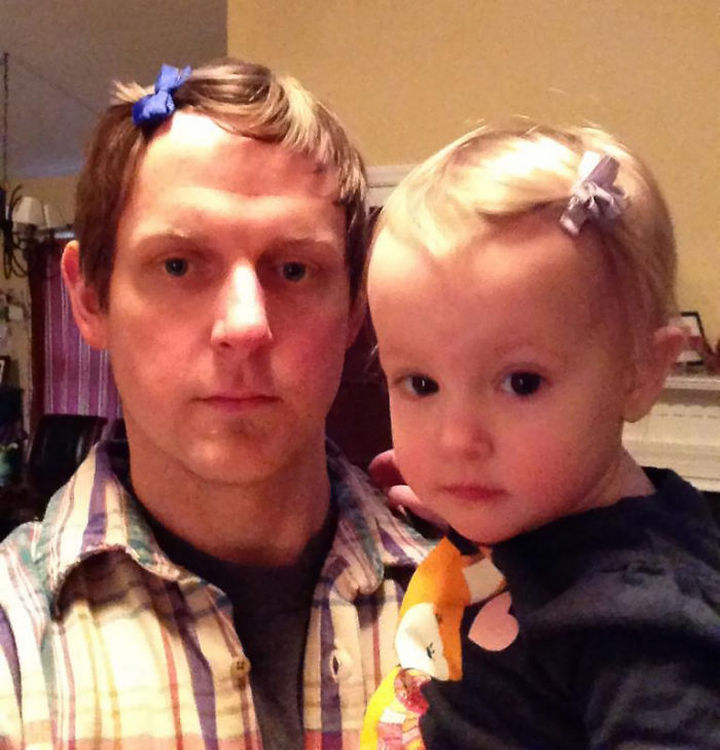 16 Super Dads Are Heroes to Their Kids - This little cutie likes her daddy to wear hair bows just like her.