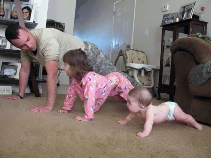 16 Super Dads Are Heroes to Their Kids - This father showing his kids how to stay fit. The baby doing pushups is priceless.