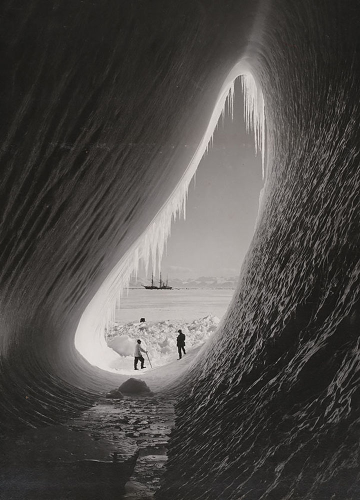 21 Historical Photos - Grotto in an iceberg, photographed during the British Antarctic Expedition, 1911.