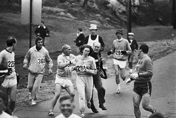 21 Historical Photos - Race organizers try to stop Kathrine Switzer from competing in the Boston Marathon. She became the first woman to run the race as a numbered entry, 1967.