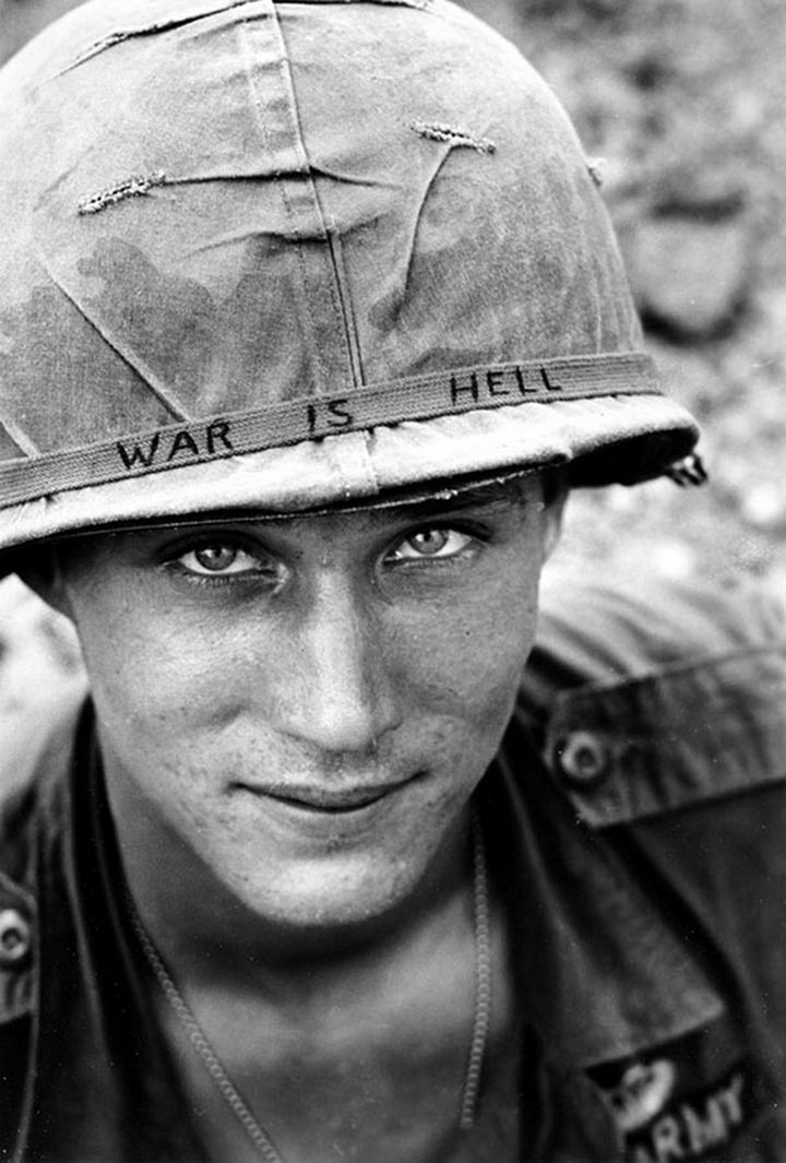 "21 Historical Photos - Unidentified US Army soldier wearing a hand-lettered""War Is Hell"" slogan on his helmet, 1965."