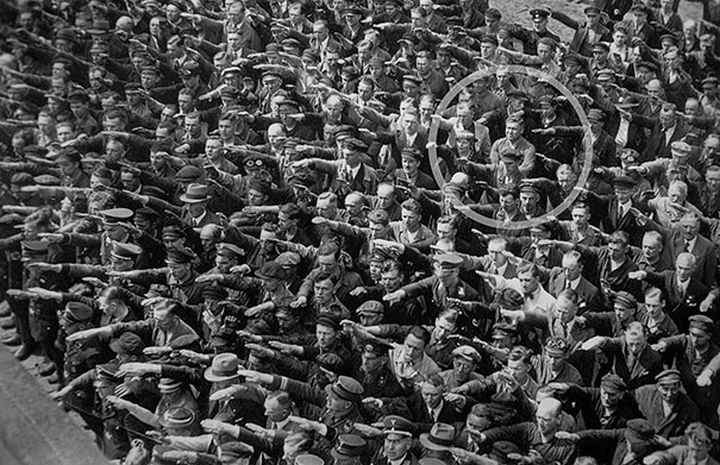 21 Historical Photos - A lone man refusing to do the Nazi salute, 1936.