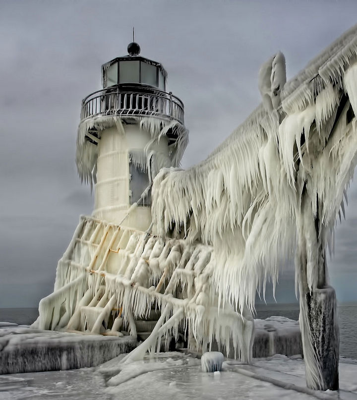 22 Ice and Snow Formations - Frozen Lighthouses on Lake Michigan Shore.