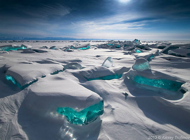 22 Ice and Snow Formations - Emerald ice on Lake Baikal, Russia.