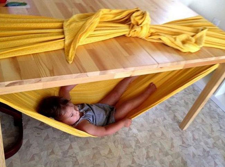 24 Life Hacks for Kids - Make a quick hammock using only a table and a blanket.