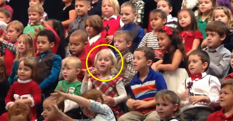 LIttle Girl Signs during Her Kindergarden Christmas Concert.