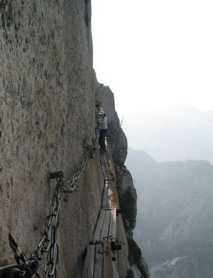 Planks to walk on and chains to grasp are the only tools you get to climb the mountain.