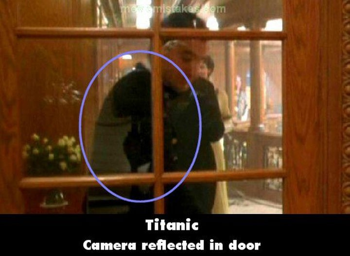 20 Titanic Movie Mistakes - Camera reflected in door.