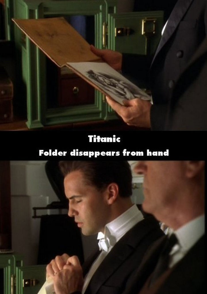 20 Titanic Movie Mistakes - Folder disappears from hand.