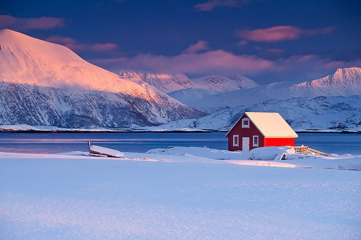 22 Cozy Houses in a Winter Paradise - Beautiful red lakeside house in Tromso, Norway.