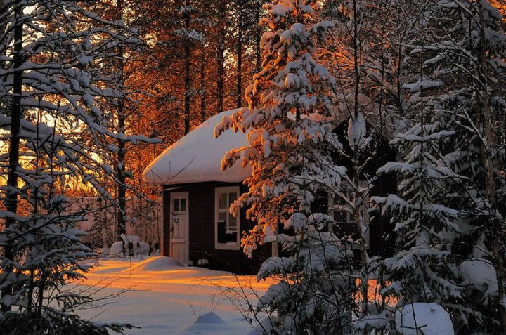 22 Cozy Houses in a Winter Paradise - A snowy cabin tucked away.