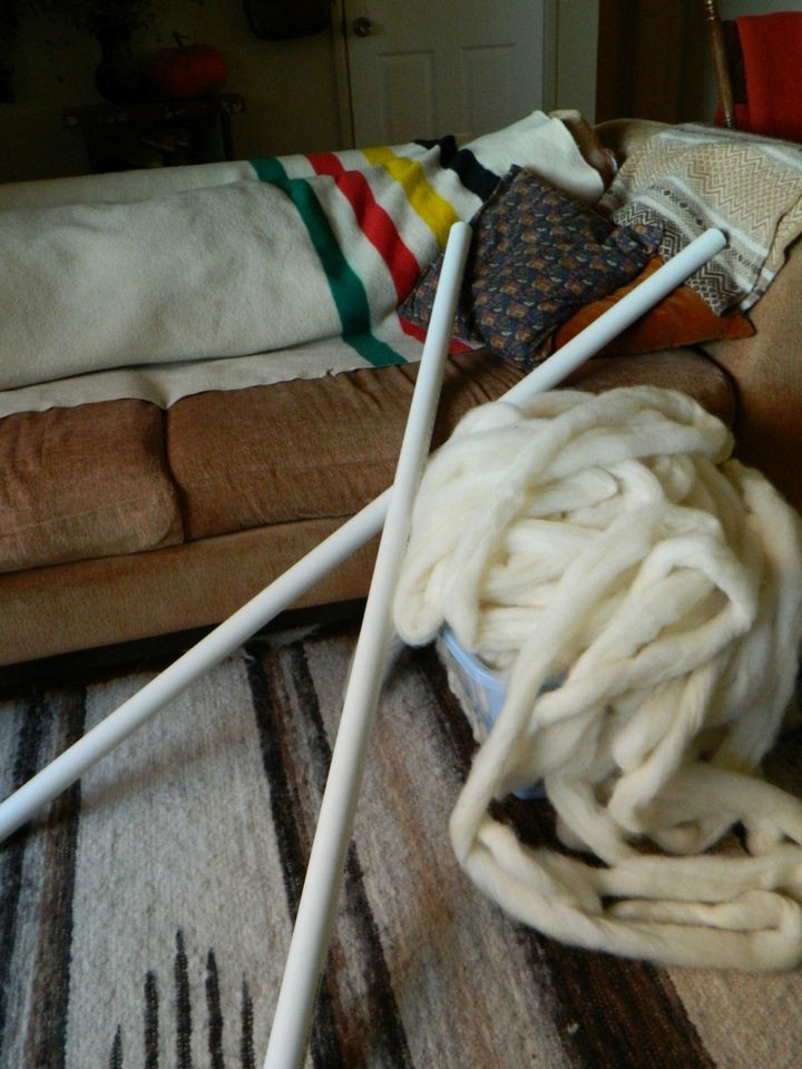 Tools of the trade. She used long pieces of PVC pipes for knitting needles.