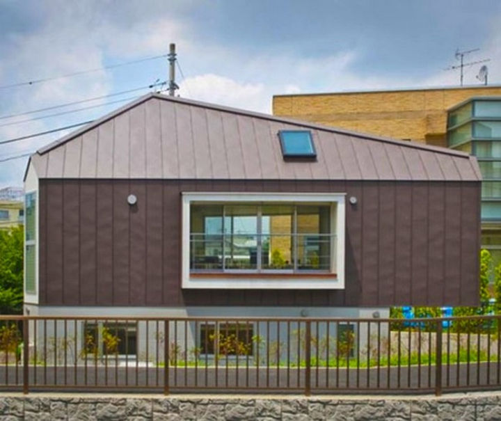 Small House Design in Japan - The triangular home features plenty of windows to let natural light in.