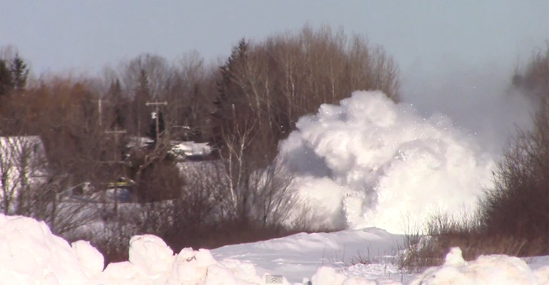 Train Barrels through a Mountain of Snow in New Brunswick.