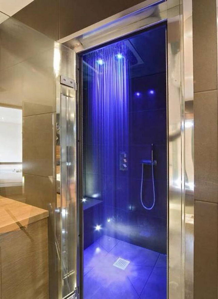 13 Beautiful Showers - Rainfall shower with neon lights.