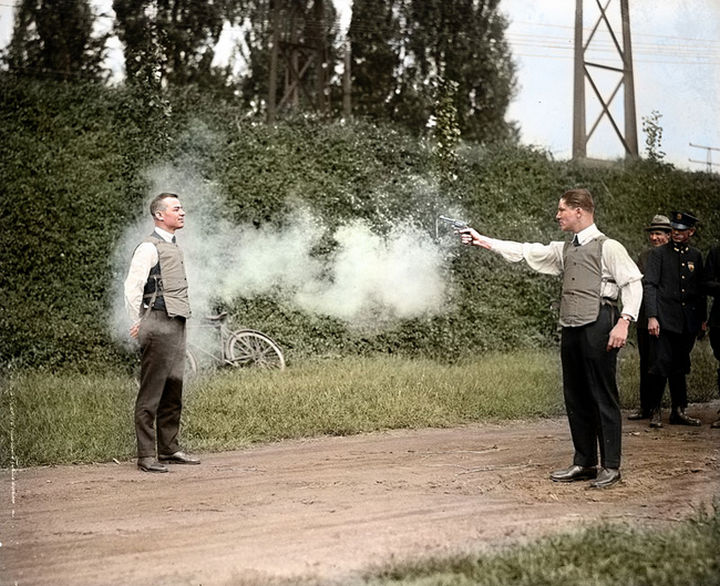 58 Colorized Photos from the Past - W.H. Murphy and his associate demonstrating their bulletproof vest in October, 1923.