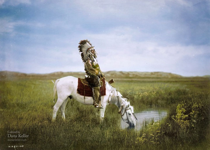 58 Colorized Photos from the Past - Red Hawk of the Oglala Sioux on horseback in the Badlands of South Dakota, 1905.