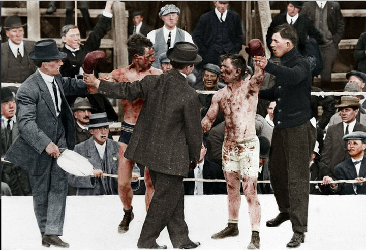 58 Colorized Photos from the Past - Two boxers after a boxing event.