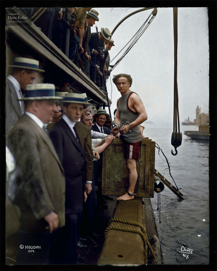 58 Colorized Photos from the Past - Harry Houdini steps into a crate at New York Harbor as part of an escape stunt in July, 1912.
