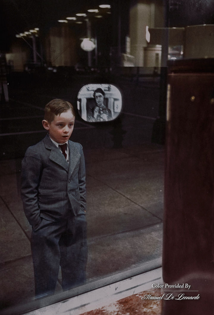 58 Colorized Photos from the Past - A young boy seeing a television for the first time.