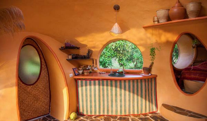 Everything is made from natural materials including this grass mat that hides the refrigerator and swing-out stove.