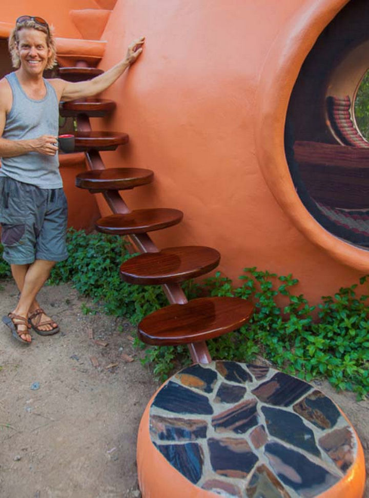 Steve is pictured next to his custom dome home and is proud of the awesome home he constructed.