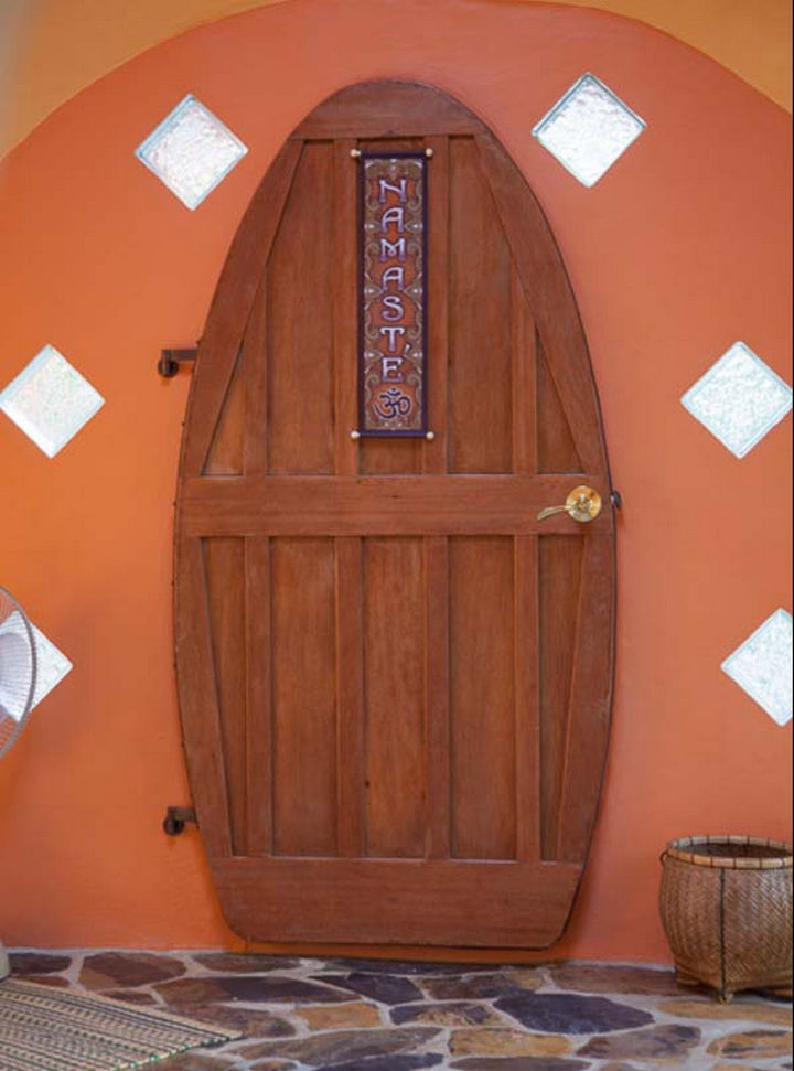 The beautiful door is made from 100% reclaimed mahogany and the entrance is accented with glass blocks.