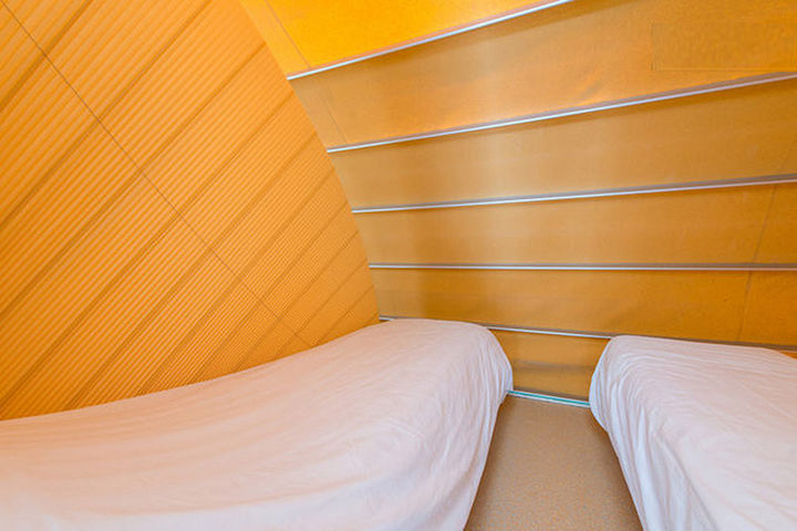The collapsible walls of 'The Marquis' offer privacy in the bedroom while a clear wall is available for the living/dining area.
