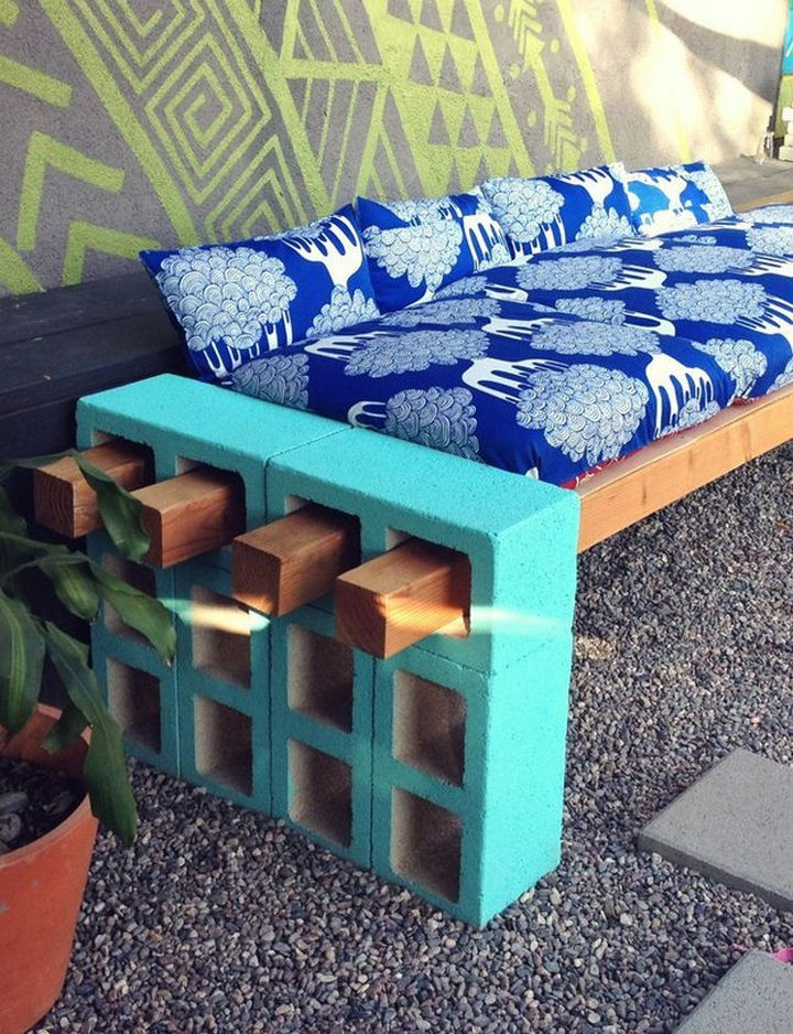 34 DIY Backyard Ideas for the Summer - Stack a few cinder blocks and insert wood beams to create an outdoor couch or bench.