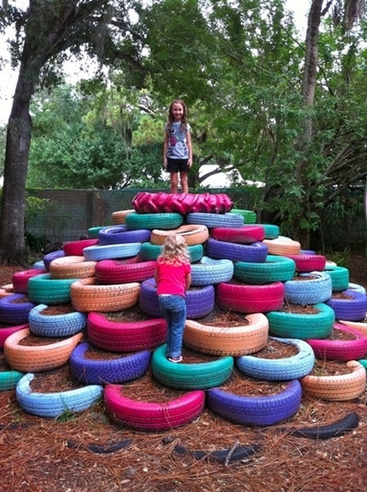 34 DIY Backyard Ideas for the Summer - Repurpose used tires and made a backyard playground.