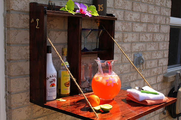 34 DIY Backyard Ideas for the Summer - Build a hideaway bar for easy outside entertaining.