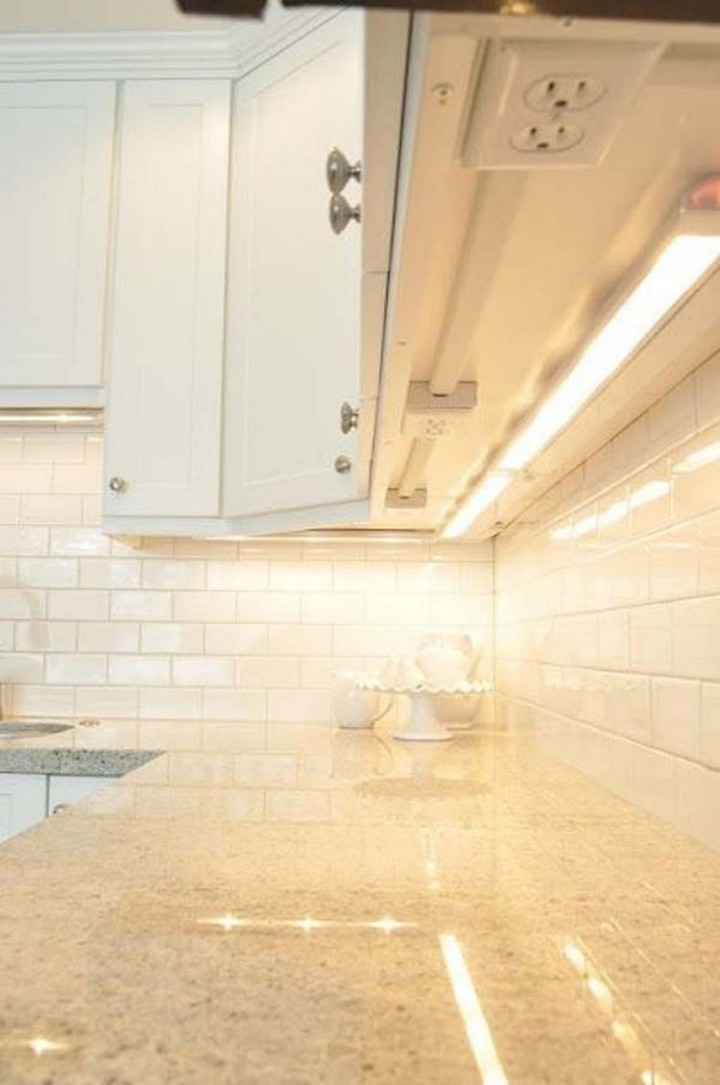 Install unsightly electrical outlets under your cupboards and keep your backsplash clean-looking - 37 Home Improvement Ideas
