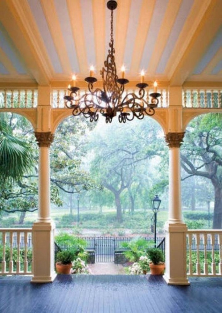 Bring some flair to your porch by installing a rustic chandelier - 37 Home Improvement Ideas