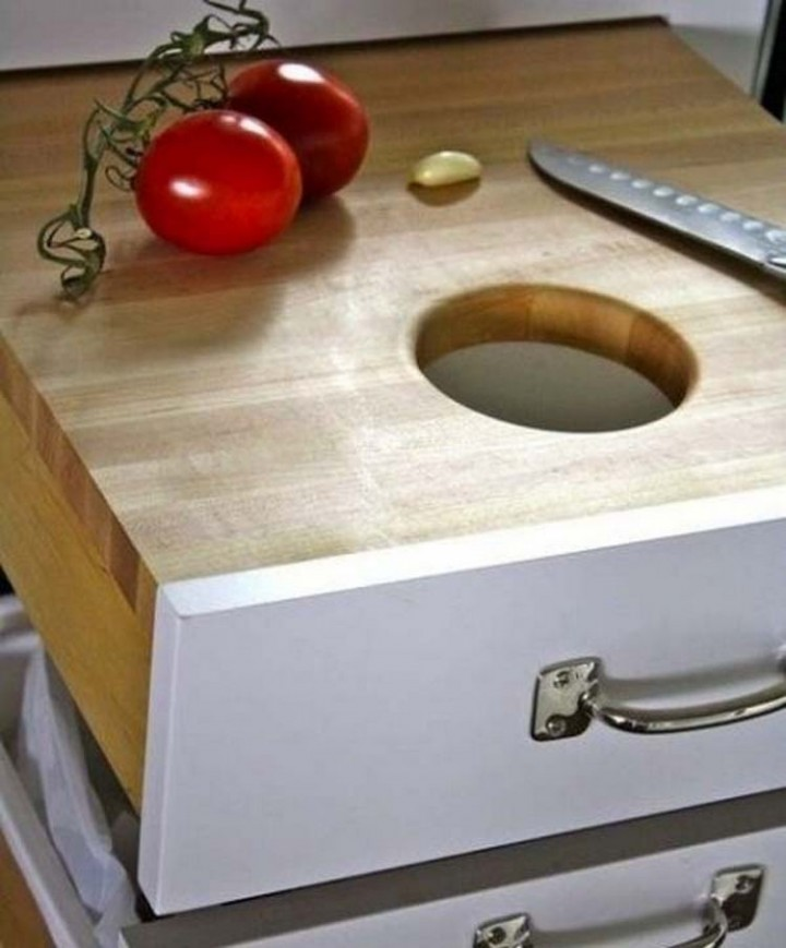 Build a cutting board drawer over your thrash bin for easy cleanups - 37 Home Improvement Ideas